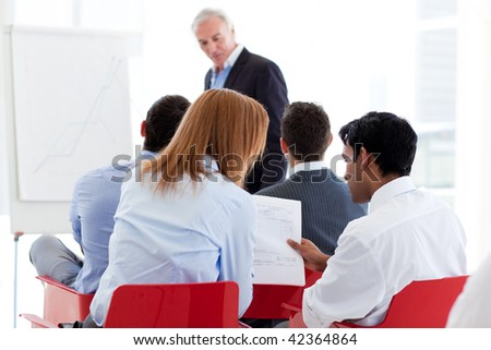 Two colleagues discussing together at a seminar in the office - stock photo