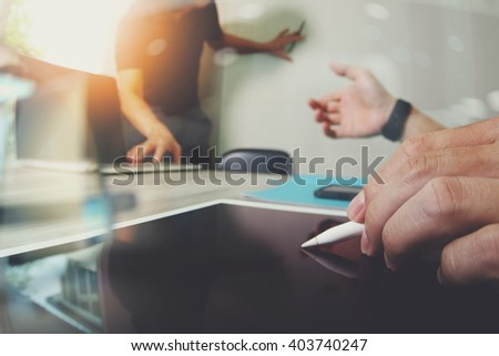 two colleagues web designer discussing data and blank screen digital tablet and computer laptop with smart phone on wooden desk as concept - stock photo