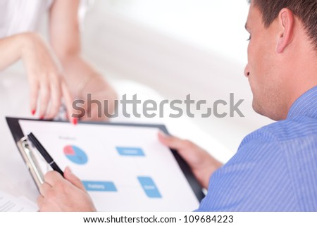 Two colleagues working in office - stock photo
