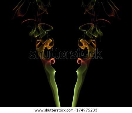 two colored wisps of smoke - stock photo