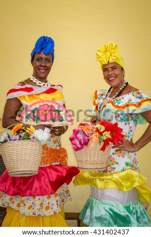 Two colorful Cuban ladies in traditional costumes - stock photo