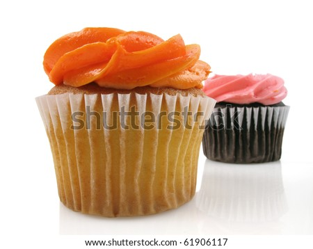 Two colorful cupcakes in different flavors on white - stock photo