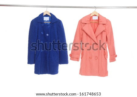 Two colorful female coat on a hanger  - stock photo