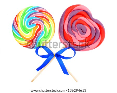 Two colorful lollipops with bow isolated on white - stock photo