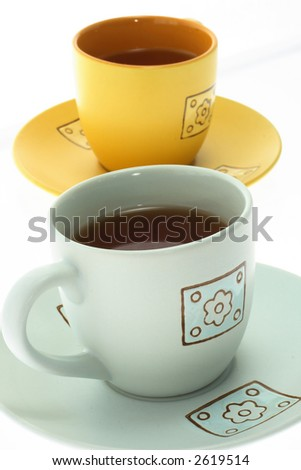 Two colorful tea cups on a white background - stock photo