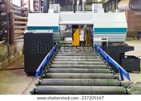 two-column band saw cutting machine for vertical cuts in mechanical workshop - stock photo