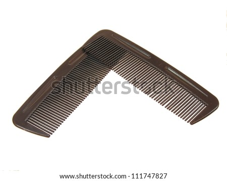 Two Combs on a White Background - stock photo