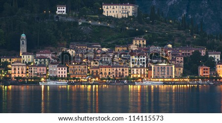 Two Como ferries resting in the harbour of Bellagio lake Como northern Italy - stock photo