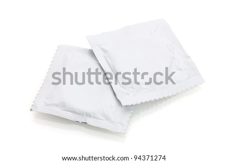 Two condoms isolated on white - stock photo