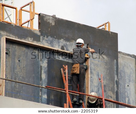 Two construction workers on construction site - stock photo