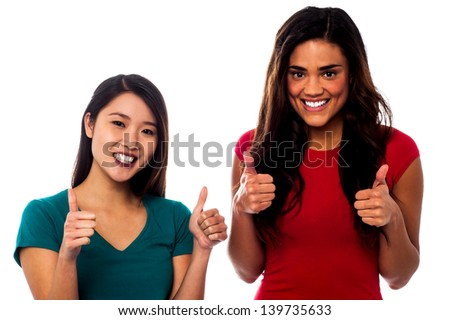 Two cool friends showing double thumbs up - stock photo
