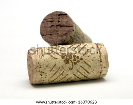 Two corks from wine bottles on white background - stock photo
