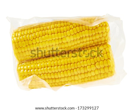 Two cornstick corn on the cob in a plastic vacuum packaging isolated over white background - stock photo