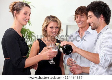 Two couple enjoying a successful year - stock photo