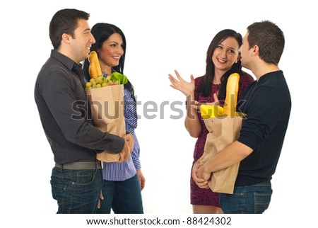 Two couple meeting at shopping for food and having conversation isolated on white background - stock photo
