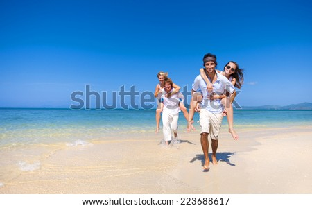Two couple relaxing on the beach. - stock photo