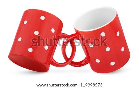 Two coupled red polka dot mugs isolated on white with clipping path - stock photo