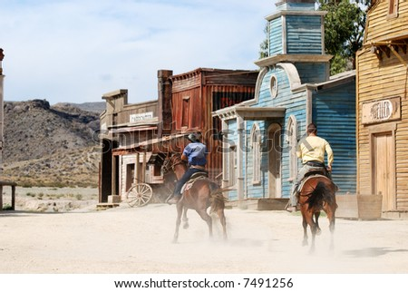 Two cowboys in a traditional American western town - stock photo