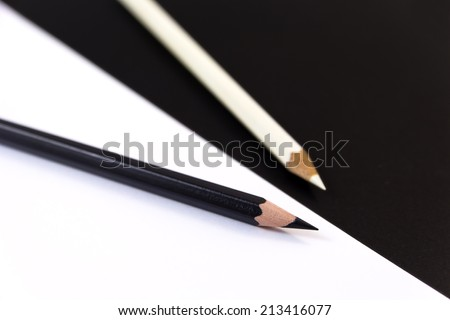 Two Crayons in black and white with black and white background. - stock photo