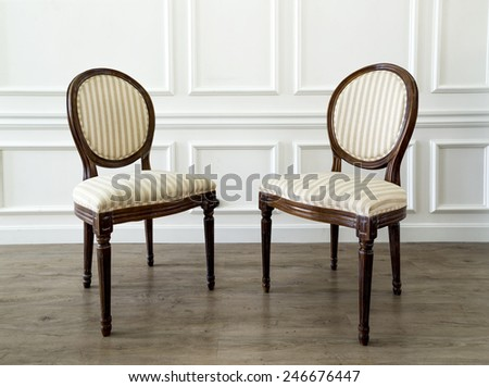 Two creamy chairs in living room - stock photo