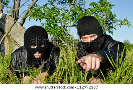 Two criminals getting ready for offense - stock photo