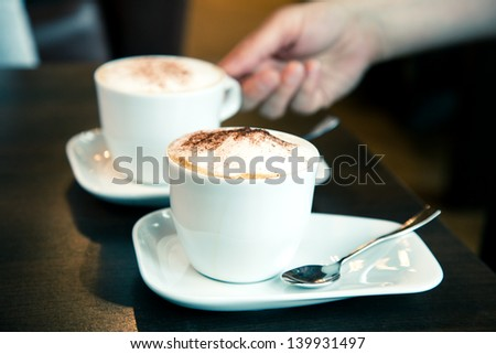 two cup of coffee on table in the cafe - stock photo