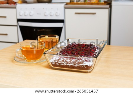 Two cup of tea and chocolate pie with cherry on the domestic kitchen - stock photo