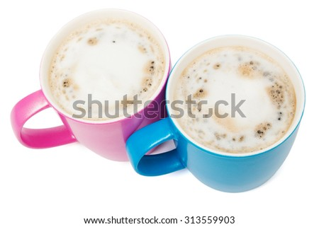 two cups of cappuccino on a white background - stock photo