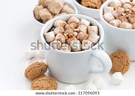 two cups of cocoa with marshmallow and cookies, closeup - stock photo
