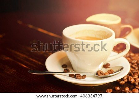 Two cups of coffee on wooden table - stock photo