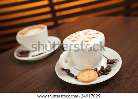 Two cups of coffee (shallow DOF) - stock photo
