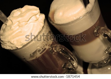 Two cups of coffee: Viennese coffee and Cafe Au Lait, processed in sepia for the retro effect - stock photo