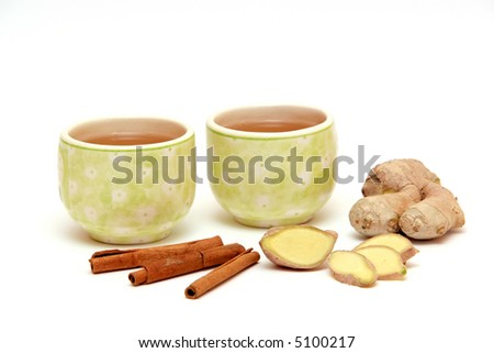two cups of green tea with ginger and cinnamon - stock photo