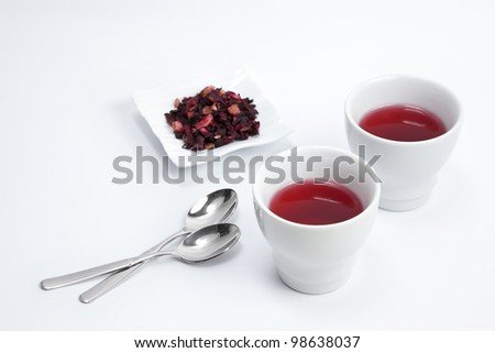 Two cups of red infusion - stock photo