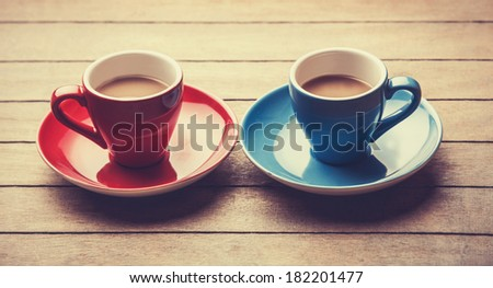 Two cups of the coffee. Photo in old color image style. - stock photo
