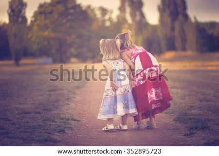 two curious little girls - stock photo