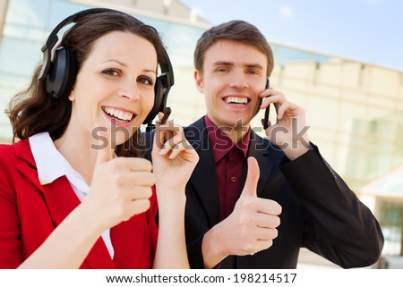 Two  customer support operators with smiling - stock photo