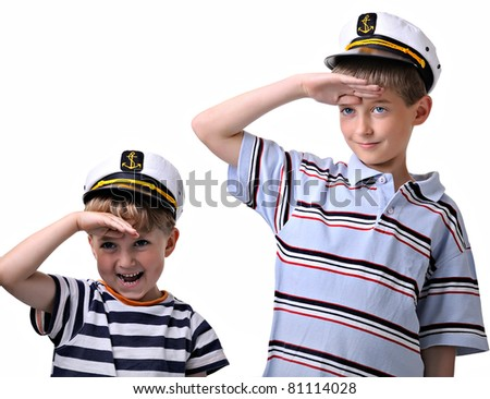 two cute boys dressed like a sailor, both in captain cap. isolated over white background. - stock photo