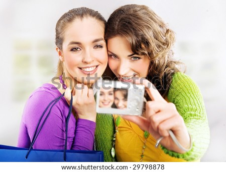 Two cute girls and a camera - stock photo