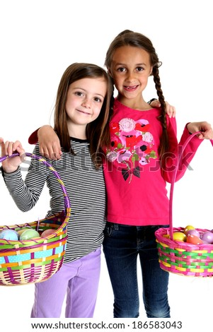 Two cute girls holding up Easter baskets - stock photo