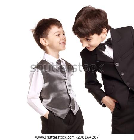 two cute little boys speaking in studio - stock photo
