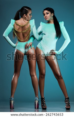 two dancers in blue costumes - stock photo