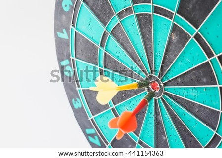 Two darts arrows in the target center. - stock photo