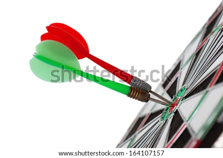 Two darts in center of target isolated on white - stock photo