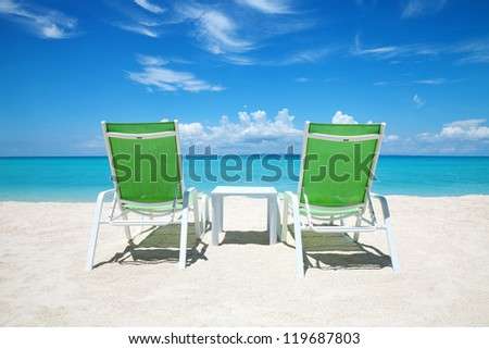Two deckchairs on a beautiful beach - stock photo