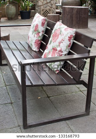 Two Decorative Cushion On Wooden Bench - stock photo