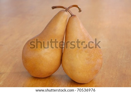 Two Delicious Bosc Pears on a Wooden Table, Still Life Photo - stock photo
