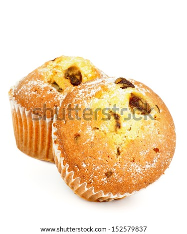 Two Delicious Homemade Muffins with Raisins and Sugar Powder isolated on white background - stock photo