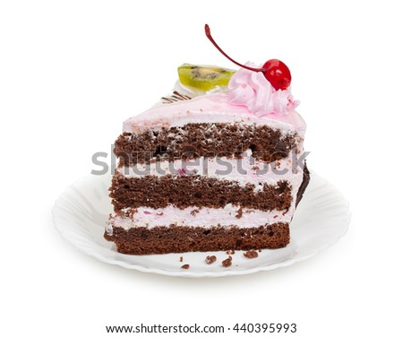 Two delicious pieces of chocolate cake with cherry cream and canned cherries, slice of kiwi on a white plate, close-up. - stock photo