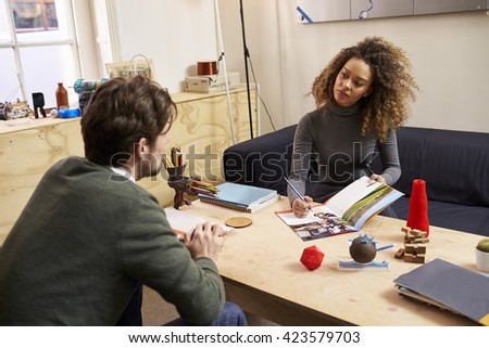 Two Designers Having Creative Meeting In Modern Office - stock photo